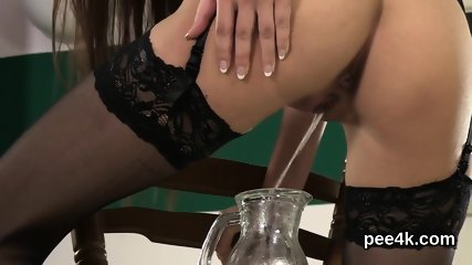 Perfect idol gets her narrow vagina entire of warm piss and splashes