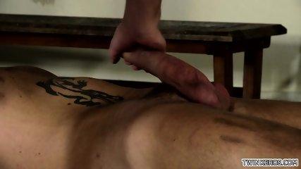 Tattoo twinks domination with cumshot