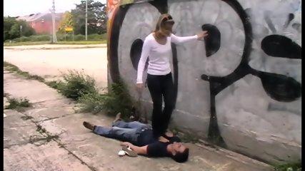 Femdom Ladies trample slaves outdoor
