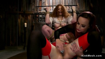 Mistress whipping two big ass lesbians