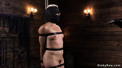 Shackled blonde with red ass fingered