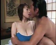 Busty Japanese Woman - scene 1