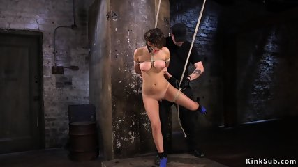 Busty tied up slave anal hooked