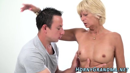 Old blonde granny blows