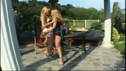 Two tight blonde Lesbians please themselves outdoor - scene 2