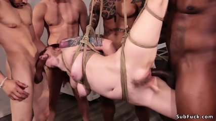 Sweaty bound redhead takes huge dicks