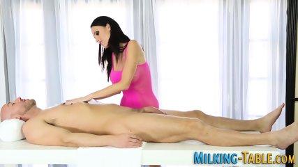 Busty masseuse tugs cock