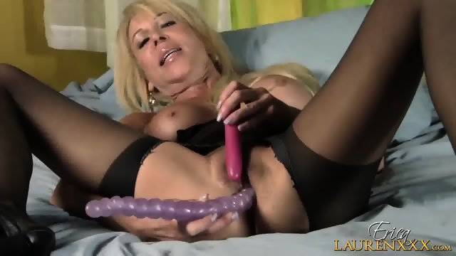 Mature Blonde Plays With Toys