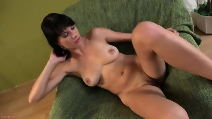 Casual Brunette In Solo Action On Armchair - scene 10