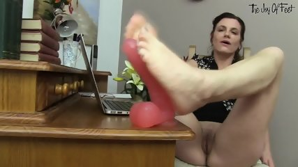 Footsie Girl Plays With Dildo