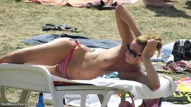 Sexy Bikini Girls Tanning At The Pool