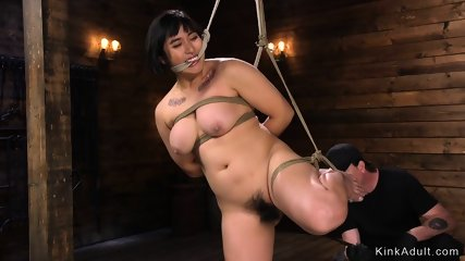 Busty hairy Asian spanked and toyed