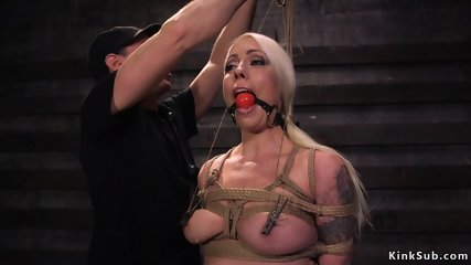 Busty slave gags huge dick at training
