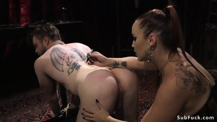 Busty dom whips and waxes naked male