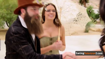 Couples are welcomed by hostess who shows them around the swing house
