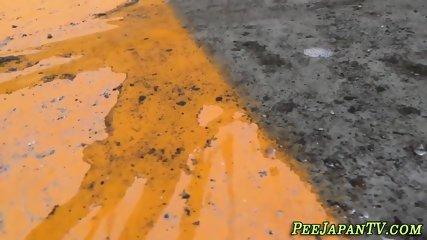 Weird asian pisses street