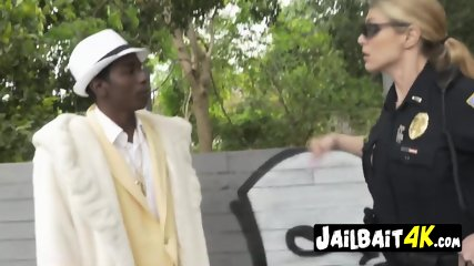 Pimp is held still while milf cop sucks and takes his big black cock