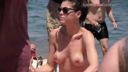 Sexy brunette babe Topless on the Beach