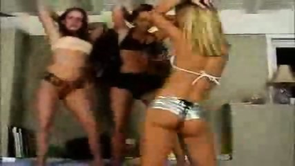 Three girlfriends dance in their room