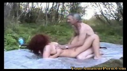 Redhead wife fucking in the woods with old man - scene 12