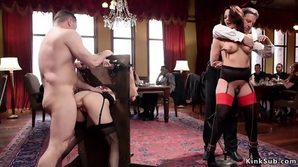 Young slave in stock fucked from behind