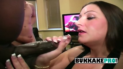 Dani deep throats on several hard loaded cocks while getting pissed on