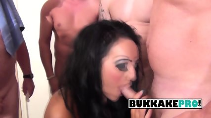 Bambi Black gets all slutty by sucking on jizz and piss loaded cocks