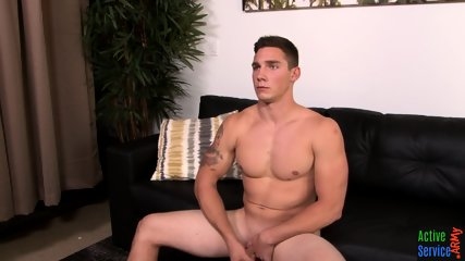 Muscly marine plays with his hard cock