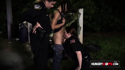 Milf cops chase suspect through a parking lot to take his cock