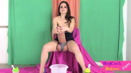 Babe strokes humungous fantasy cock topless