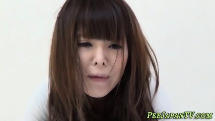 Asian peeing in her pants