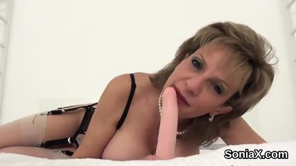 Unfaithful english mature lady sonia unveils her massive breasts