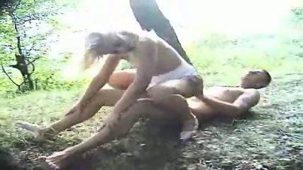 Couple having fun in the woods - scene 5