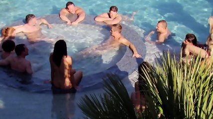 Couples surround each other in the hot tub for steamy foreplay