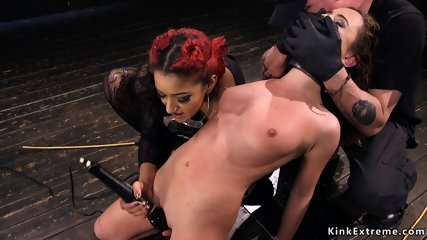 Curly brunette tormented by dominant couple