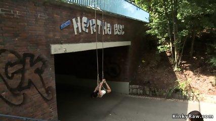 Hottie suspended from a bridge in public