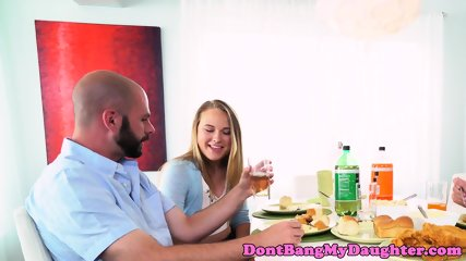 Naughty teen wanks cock under dining table - scene 1