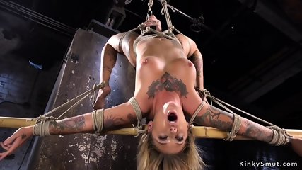 Tattooed blonde toyed in strict bondage
