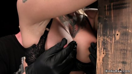 Tattooed busty blonde toyed in bondage