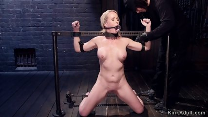 Gagged Milf in metal stocks suffering