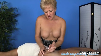 Mature masseuse with big tits strokes