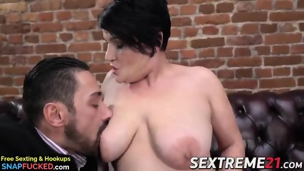 Mature babe with massive tits gets to suck on young dick