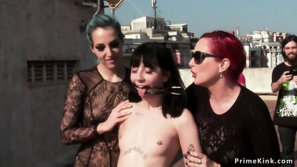 Lesbians pissing in slaves pussy outdoor