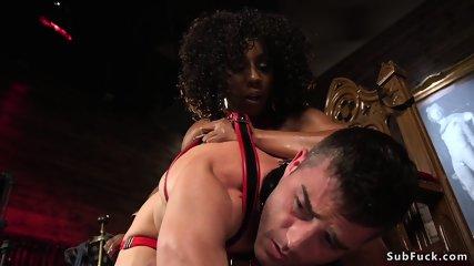 Slim ebony mistress anal fucks male sub