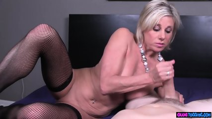 Mature beauty strokes dick in stockings