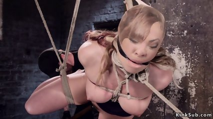 Redhead pussy fucked with toy in hogtie