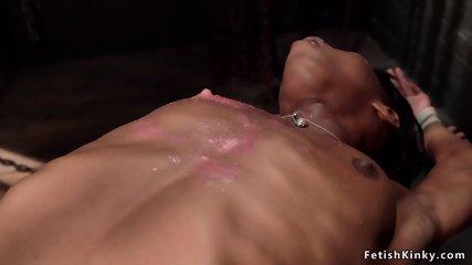 Hairy ebony slave in hogtie gets waxed