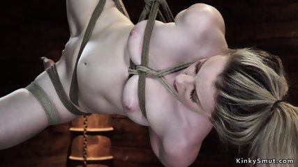 Hogtied blonde with all weight on knees