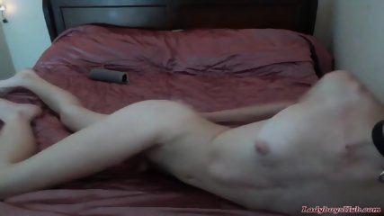 Cute trap plays with dildo