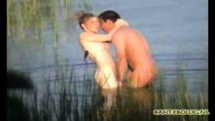 Couple captured having Sex in Lake - scene 12